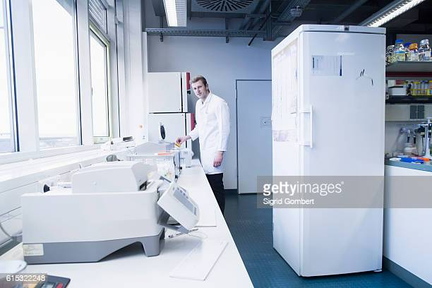 young male scientist working in a pharmacy laboratory, freiburg im breisgau, baden-württemberg, germany - sigrid gombert stock pictures, royalty-free photos & images