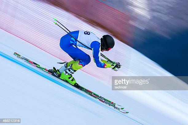 young male skier at straight downhill race - winter sport stock pictures, royalty-free photos & images
