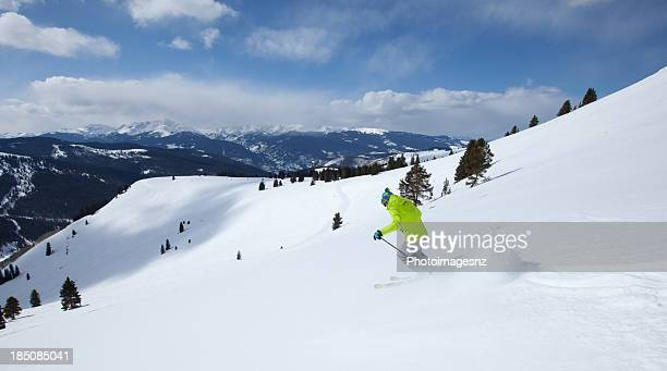 Young male skiing at speed on slopes, Vail, Colorado, USA