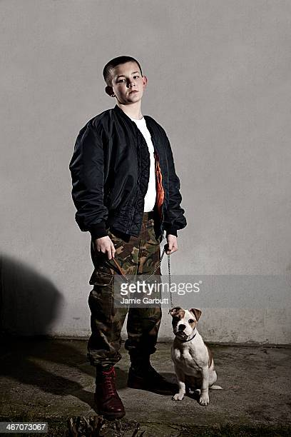 Young male Skinhead with a puppy
