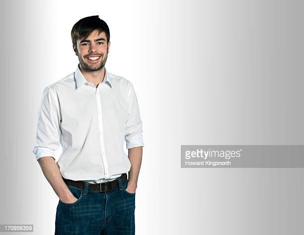 young male smiling to camera - camisa con botones fotografías e imágenes de stock