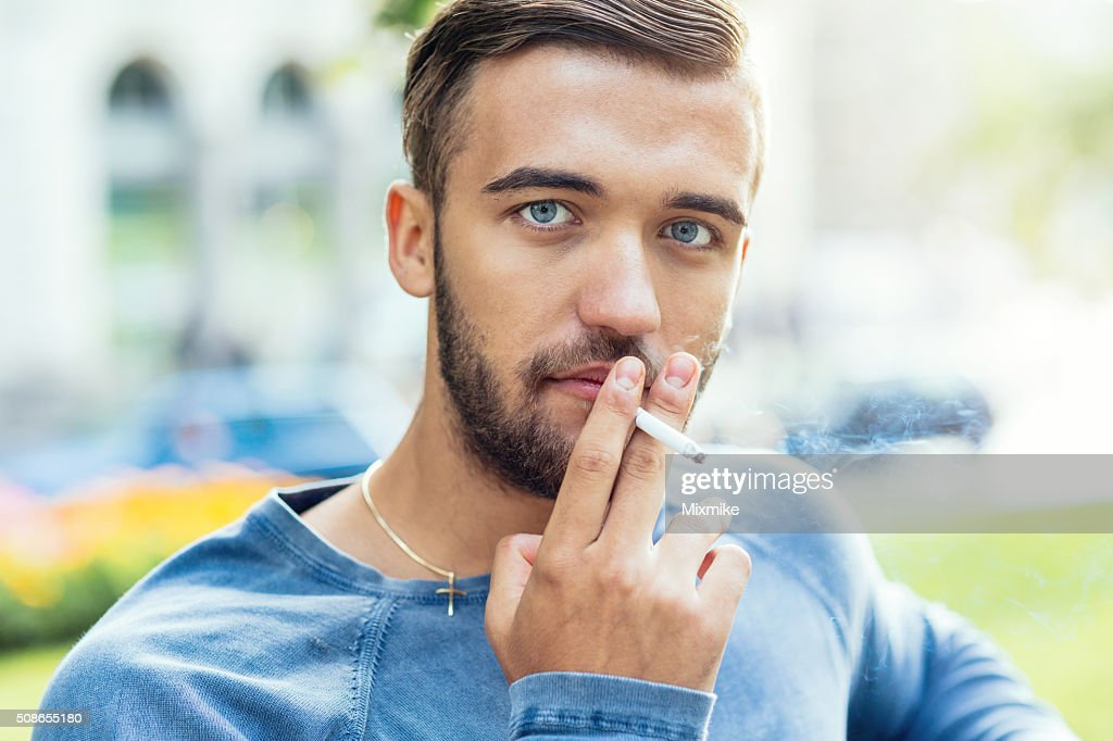 Young male smoking : Stock Photo