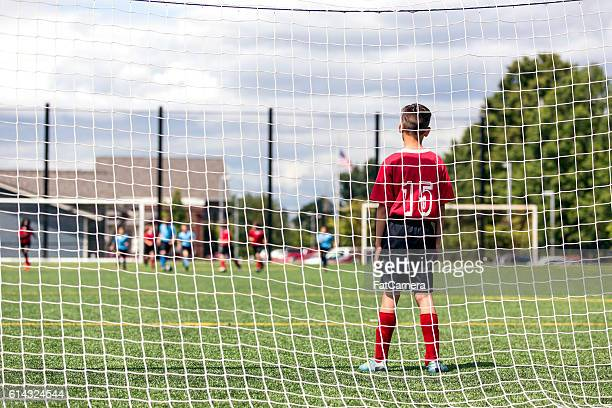 young male soccer player standing in front of the - fat goalkeeper stock pictures, royalty-free photos & images
