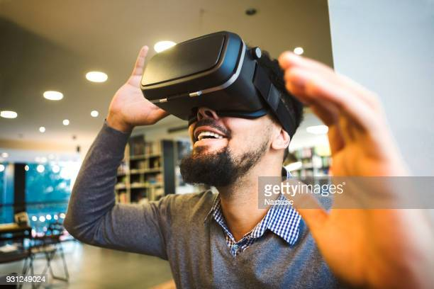 Young male student using Vr Headset for learning
