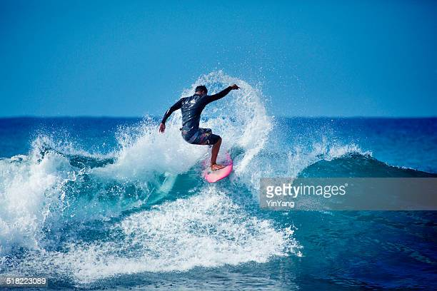 Young Male Surfer Surfing in the Water of Hawaii