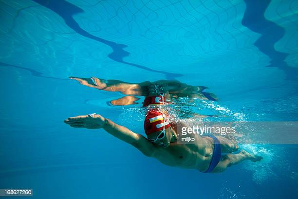 Young male swimmer in the swimming pool
