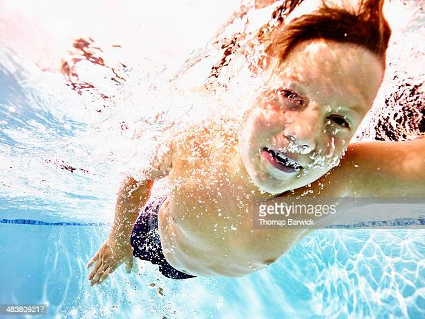 Young male swimmer swimming freestyle