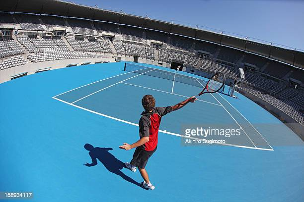 young male tennis player - hardcourt stock photos and pictures