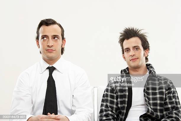 young male twins wearing formal and casual attire, portrait, close-up - zij aan zij stockfoto's en -beelden