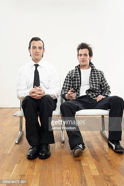 young male twins wearing formal and casual attire, portrait - zij aan zij stockfoto's en -beelden