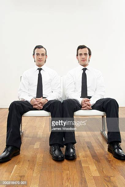 Young male twins wearing shirts and ties, portrait