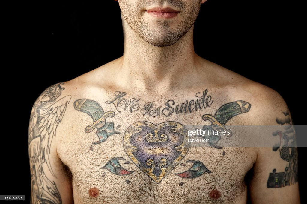 Young male with tatoos. : Stock Photo