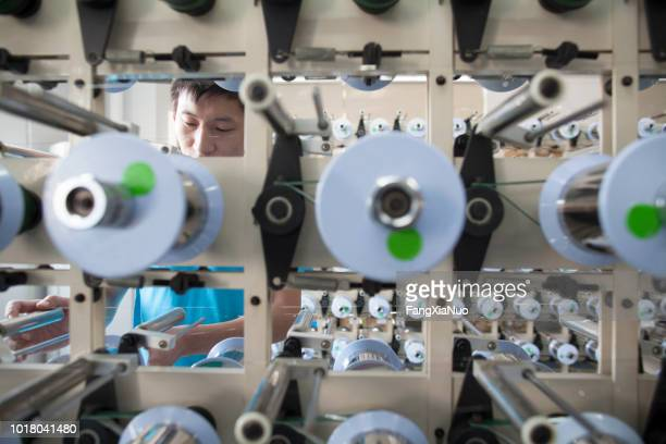 young male worker at a factory in dongguan, china - guangdong province stock pictures, royalty-free photos & images