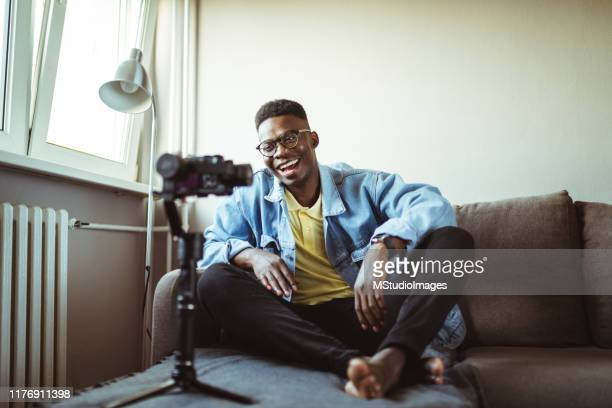 young male youtuber. - vlogging stock pictures, royalty-free photos & images