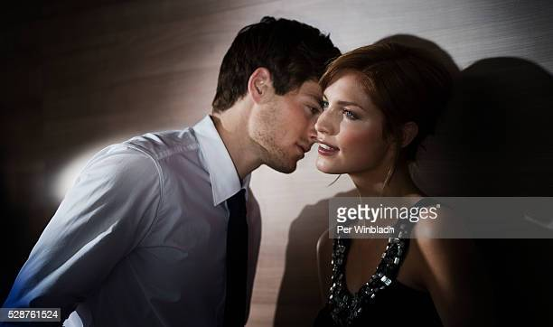 Young man about to kiss a young woman