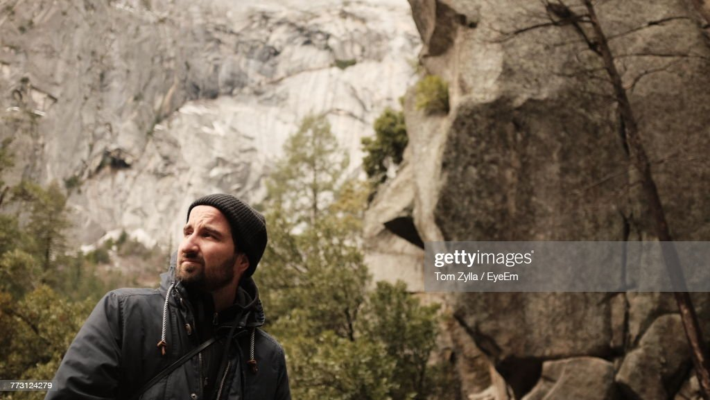 Young Man Against Rock : Photo