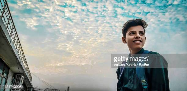young man against sky - 18 19 years stock pictures, royalty-free photos & images