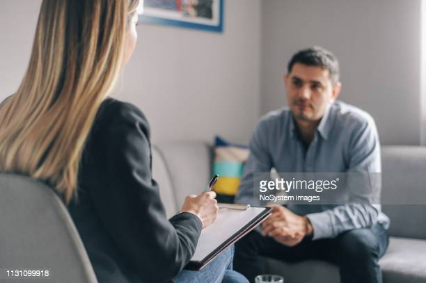 young man, alcoholic, on  therapy session - addict stock photos and pictures