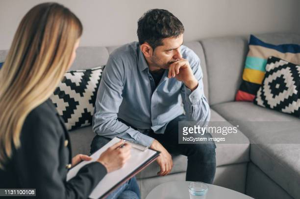 young man, alcoholic, on  therapy session - counseling stock pictures, royalty-free photos & images