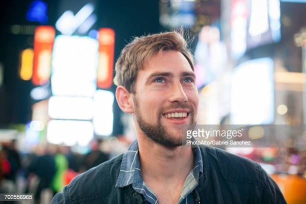 young man amazed by his surroundings, times square, new york city, new york, usa - broadway manhattan stock photos and pictures
