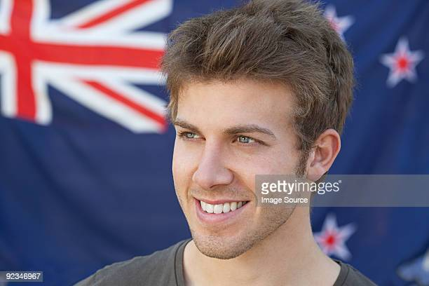 young man and and new zealand flag - new zealand flag stock photos and pictures