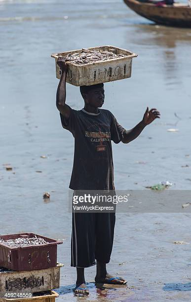 Young Man and Crate of Fish