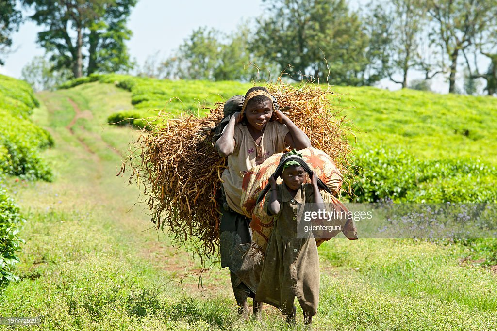 Young man and daughter are carrying a heavy load : Stock Photo