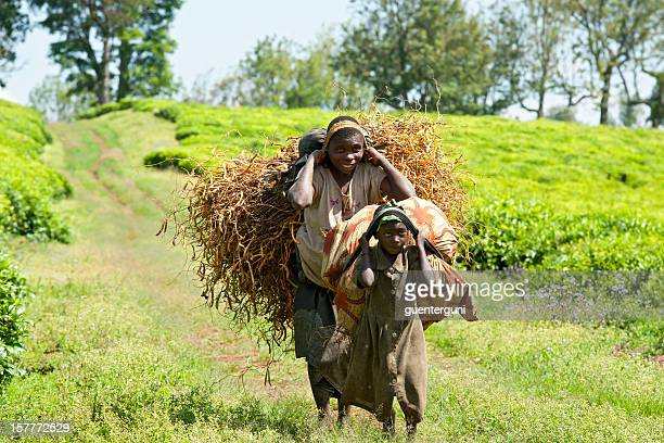 Young man and daughter are carrying a heavy load