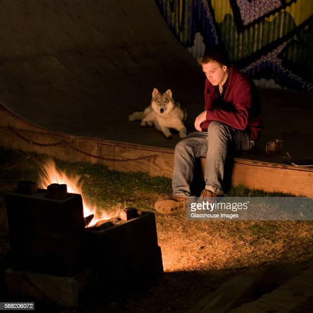 Young Man and Dog by Fire