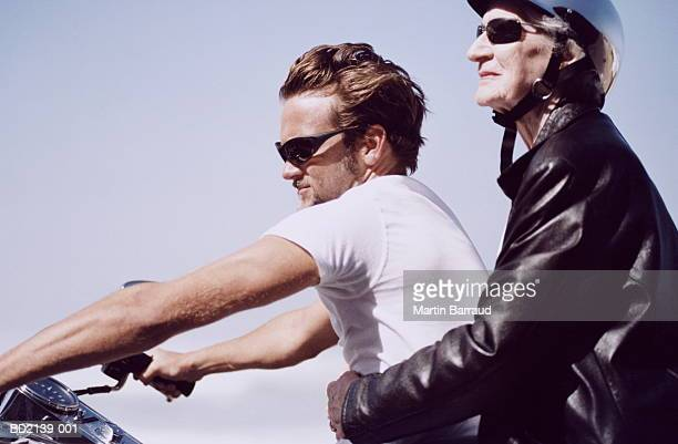 young man and elderly woman on motorbike, close-up - gigolo photos et images de collection