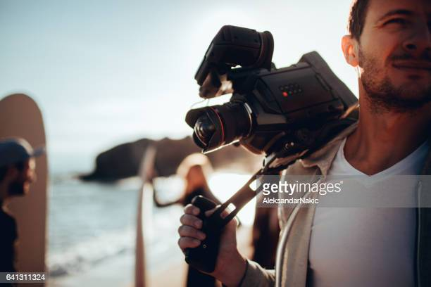 young man and his video camera - cinematographer stock pictures, royalty-free photos & images