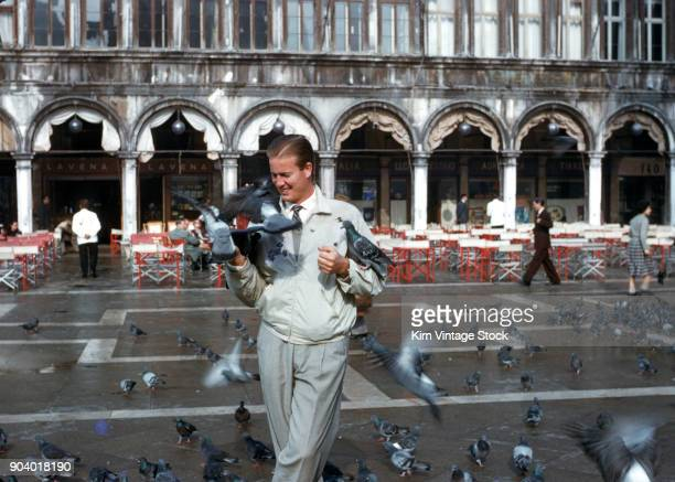 young man pigeons piazza san marco