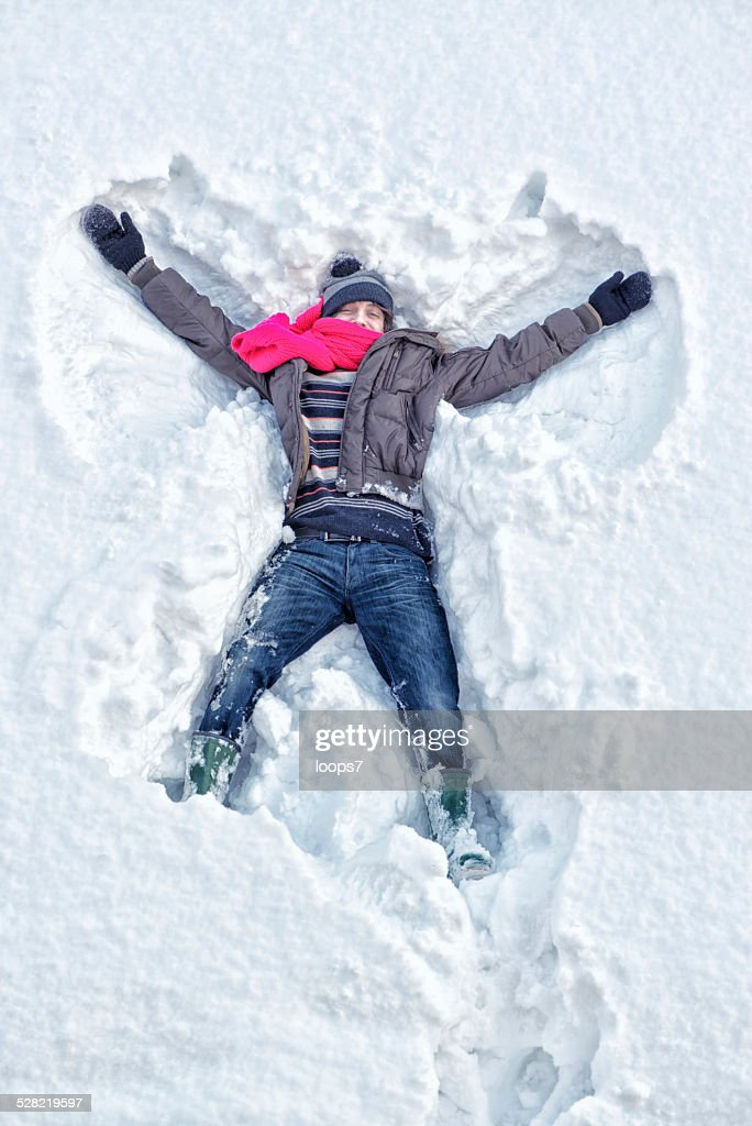 Young man and snow : Stock Photo