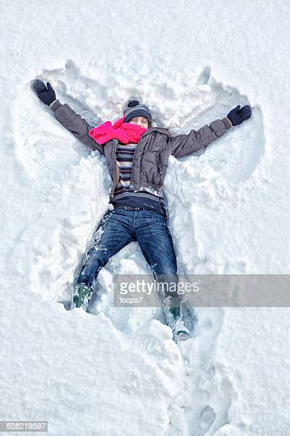 young man and snow - snow angel stock photos and pictures