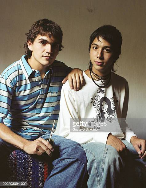 Young man and teenage boy (16-18), portrait