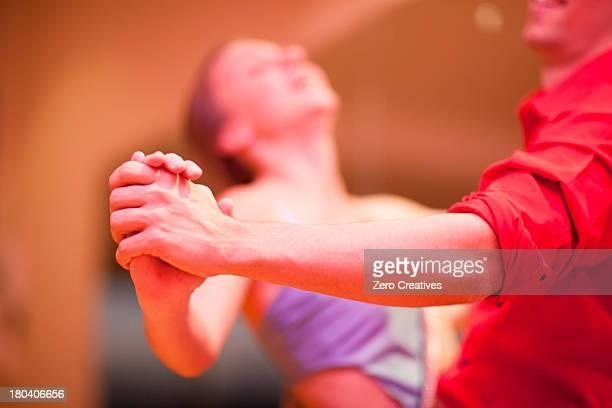 Young man and teenage girl ballroom dancers