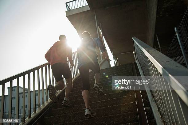 Young man and teenager tower running