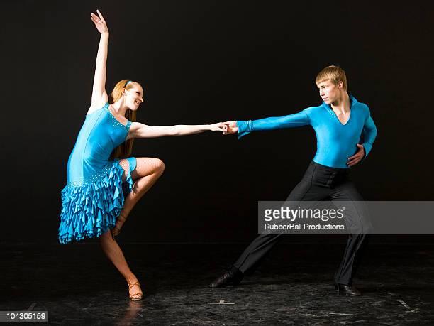 Young man and woman ballroom dancing