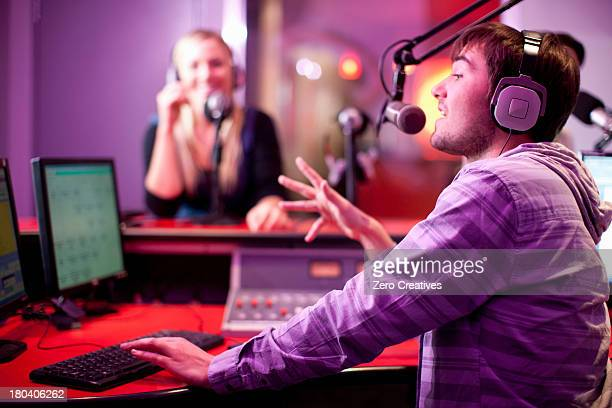 young man and woman broadcasting in recording studio - 放送 ストックフォトと画像