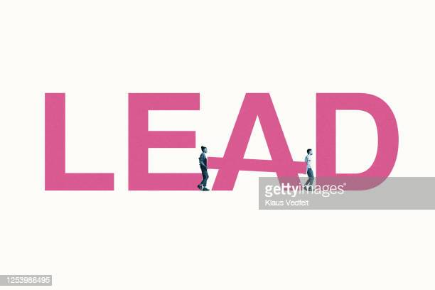 young man and woman building lead word - pbs stock pictures, royalty-free photos & images