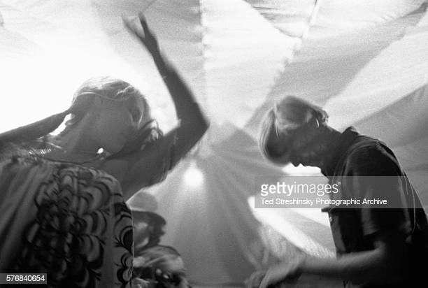 A young man and woman dance at the Acid Test Graduation party a celebration organized by Ken Kesey and his Merry Pranksters in which participants...