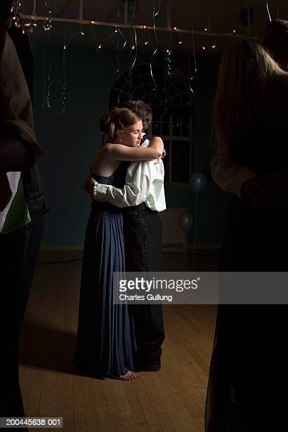 young man and woman dancing at prom, woman with eyes closed, side view - prom stock pictures, royalty-free photos & images