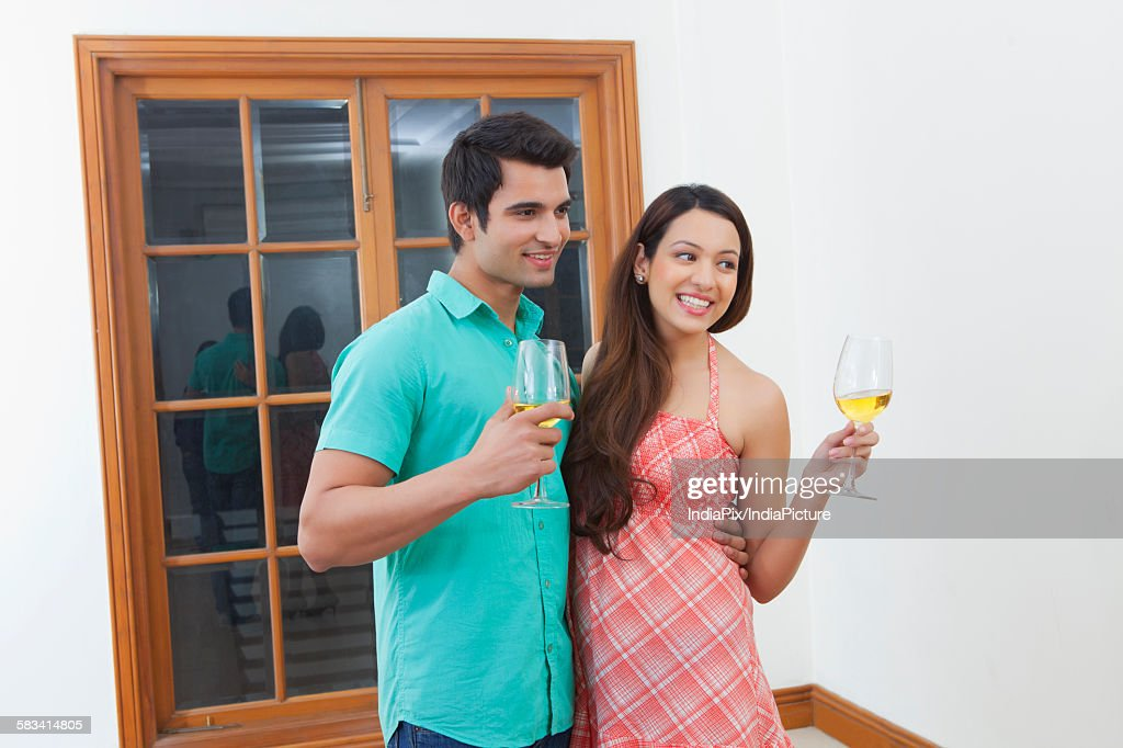 Young man and woman drinking wine : Stock Photo