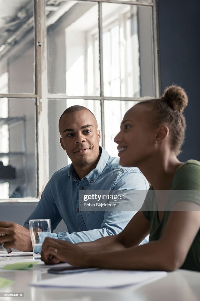 Young Man and Woman having a meeting smiling : Stock Photo