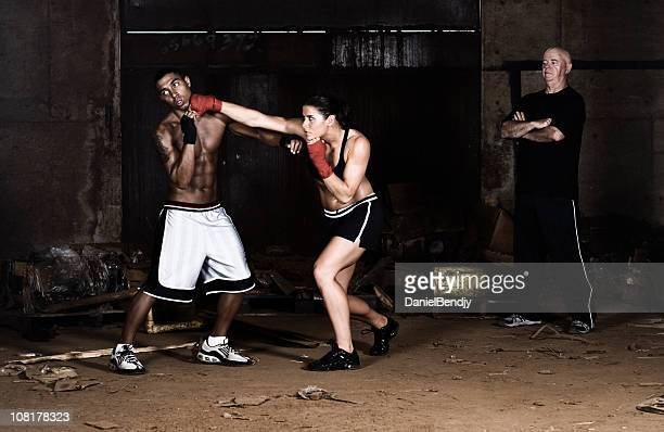 young man and woman in boxing match - mixed boxing stock photos and pictures