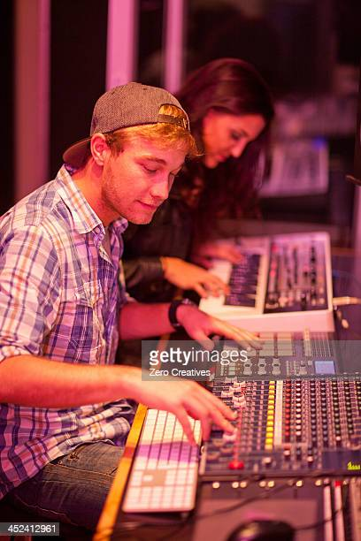 Young man and woman in college recording studio