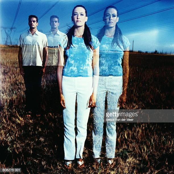 young man and woman in field, portrait (multiple exposure) - cloning stock pictures, royalty-free photos & images