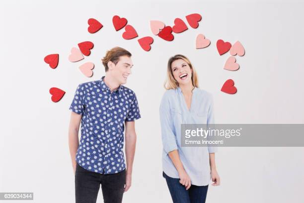 Young man and woman laughing in love