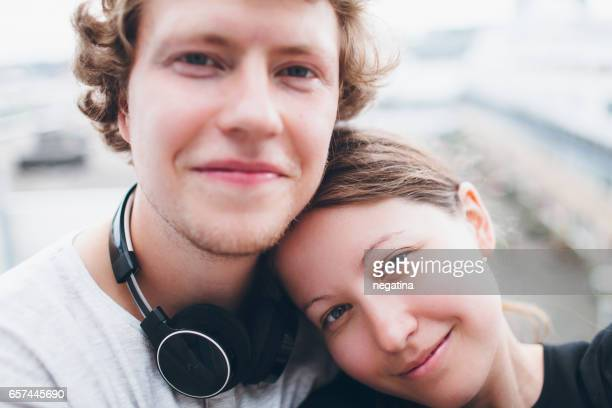 young man and woman looking at the camera in the morning in Amsterdam, Netherlands