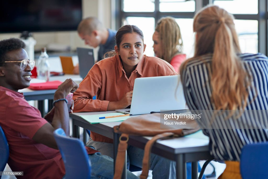 Young man and woman looking at university student : Stock Photo